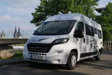 Hire a motorhome in Köln from private owners| Karmann Dexter