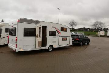 Hire a motorhome in Münchendorf from private owners| Bürstner FamilyPlus