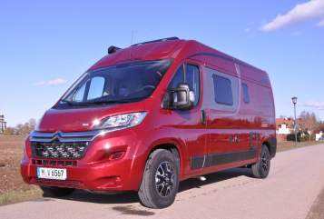 Hire a motorhome in Putzbrunn from private owners| Pössl BELLA  in red