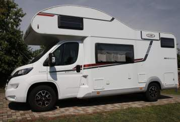 Hire a motorhome in Weitendorf from private owners| LMC Breezer Womo