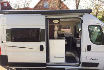 Hire a motorhome in Ahrensburg from private owners| Karmann Little Hilton