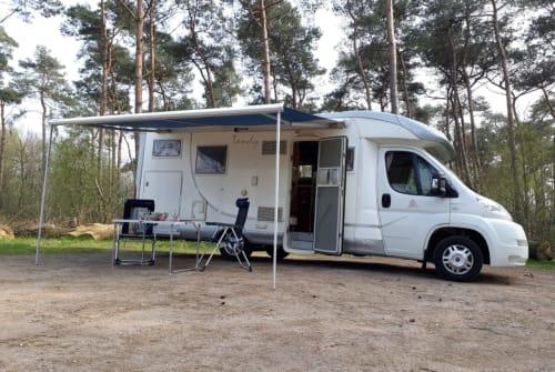 Hire a motorhome in Valkenswaard from private owners| MC Louis Tandy Camper, XL dwarsbed en grote hoge garage! MC Louis Tandy