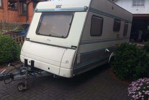 Hire a motorhome in Delingsdorf from private owners| TEC  WOWA 5 SP Etagenbetten Vorzelt